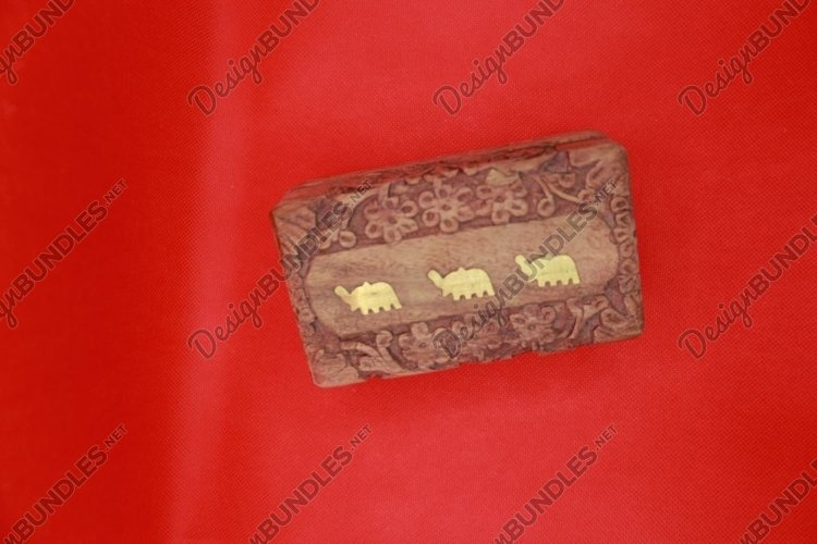 carved Indian box on a red background example image 1