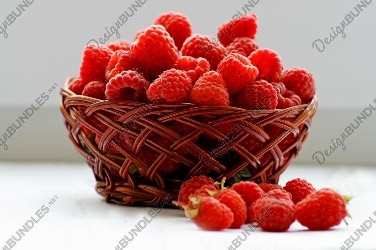 Berries red raspberries in the basket.