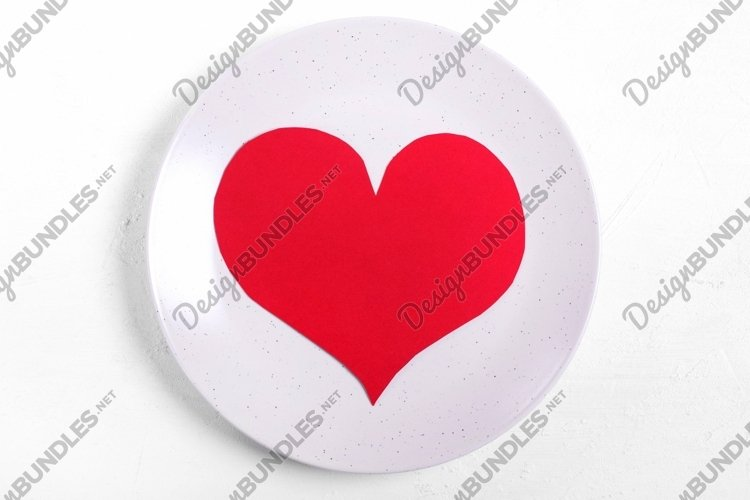 Red cardboard heart on the ceramic plate example image 1