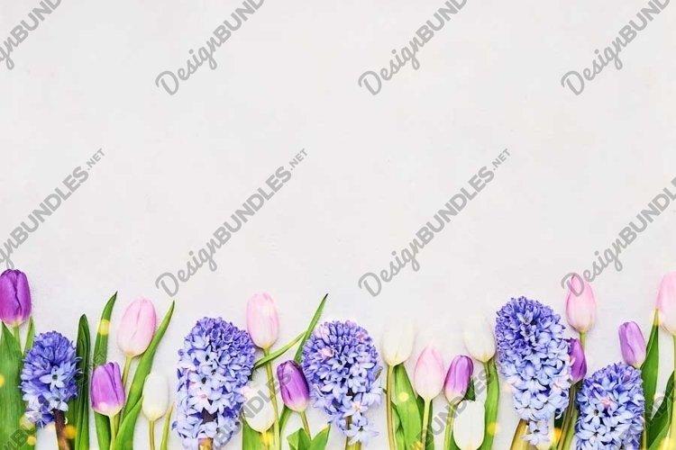 Spring flowers border on light background. example image 1