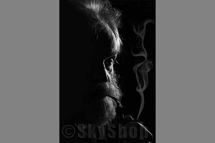 Old man with a pipe example image 1