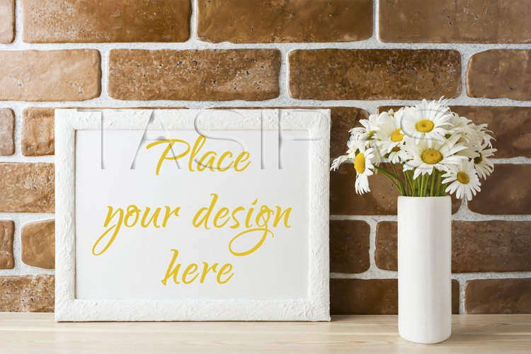 White landscape frame mockup with daisy bouquet in styled vase  example image 1