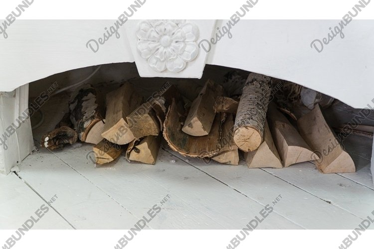 White decorated fireplace with firewood example image 1