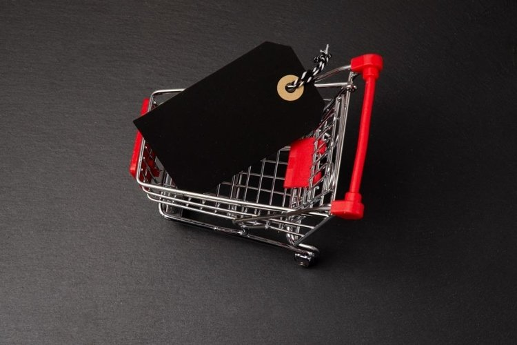 Shopping cart on the black background. Shopping card with a example image 1