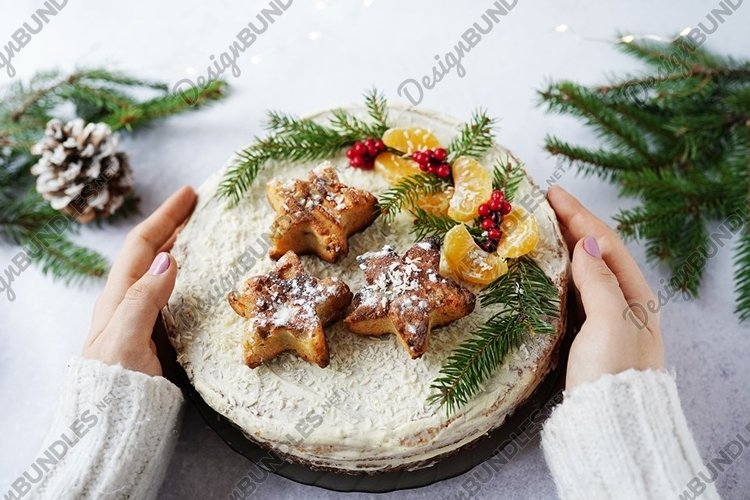 Girl hands holding a beautiful Christmas cake, winter food example image 1