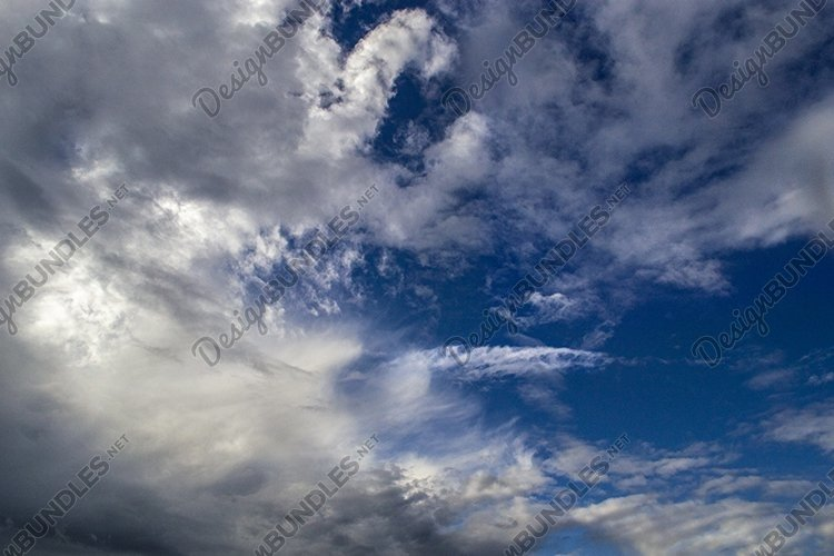 beautiful fluffy clouds in the deep blue sky