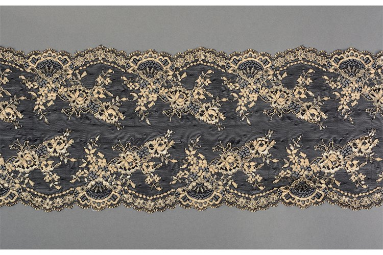 black beige straight strip of lace fabric. Texture for web example image 1