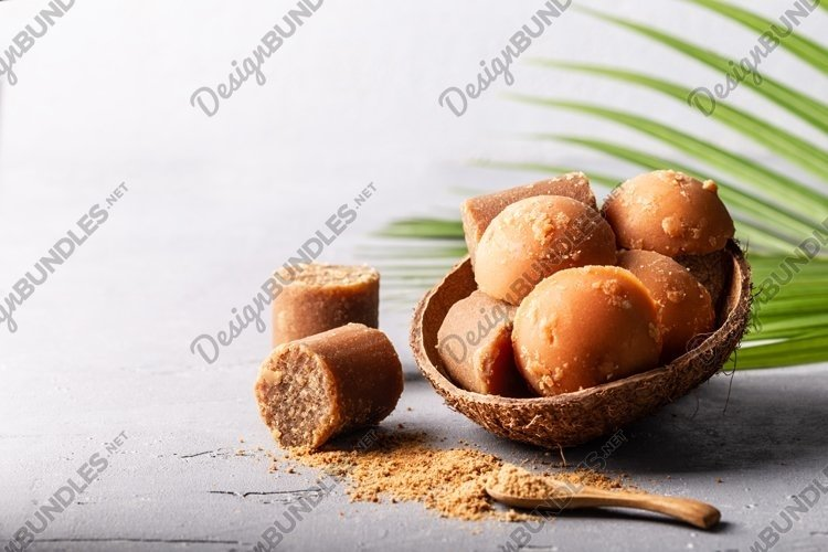 Organic brown palm sugar on grey concrete background. example image 1
