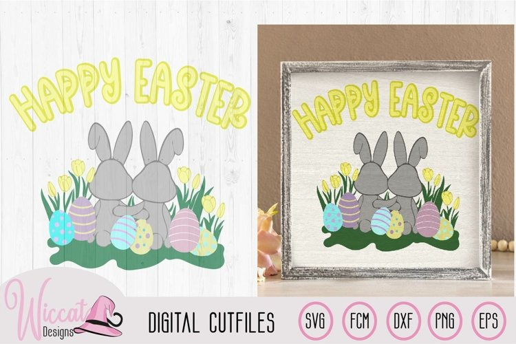 Two little bunnies in a flower field with Easter eggs