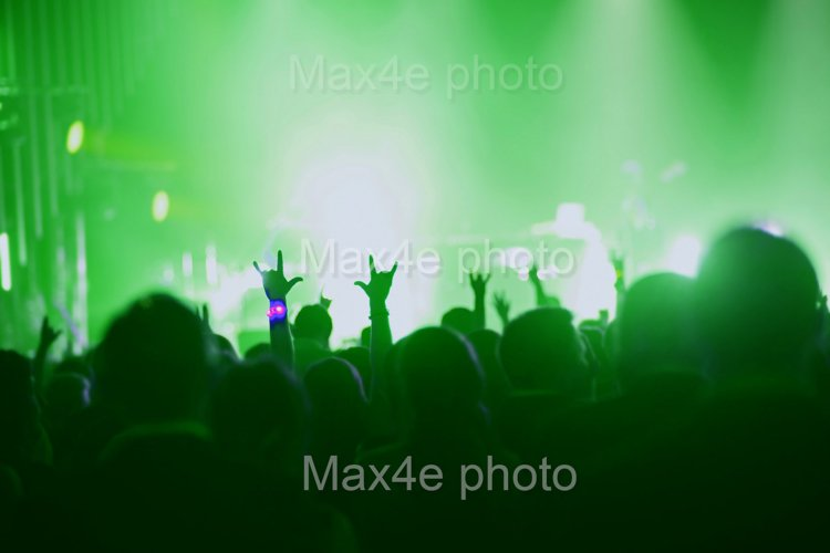 Concert, event or party concept. People with hands up