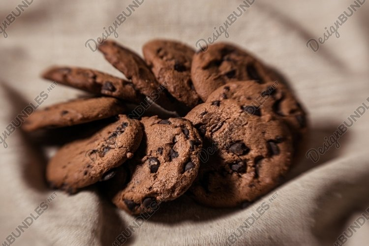 Festive chocolate cookies on linen fabric background example image 1