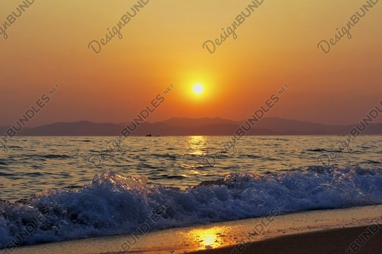 Seascape with beautiful sunset over the sea. example image 1