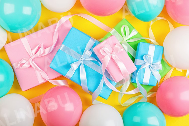 Flat lay with gift boxes and balloons on yellow background example image 1