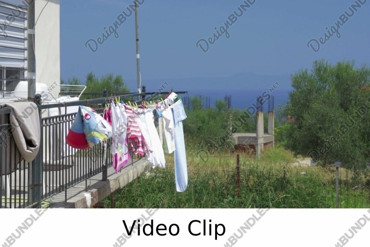 Video: Clothes Drying on the Balcony after Washing example image 1