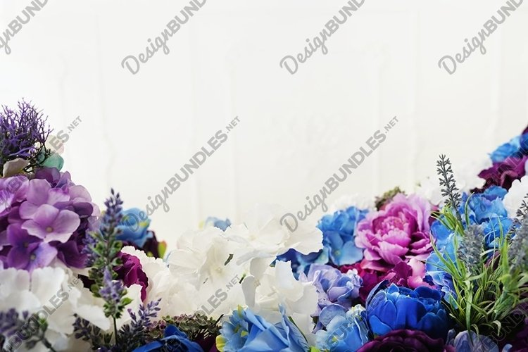 Beautiful blooming colorfull spring flowers near white wall example image 1