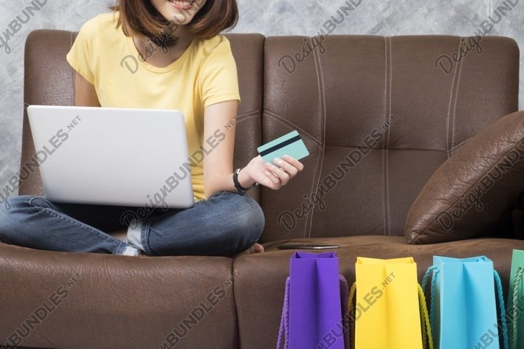 Asia woman shopping online at home. Searching product. example image 1