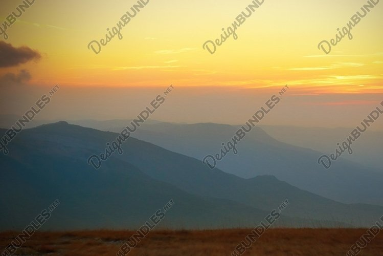 Beautiful sunset in the mountains example image 1