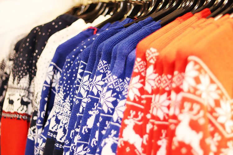 warm sweaters with Christmas ornaments in the store example image 1