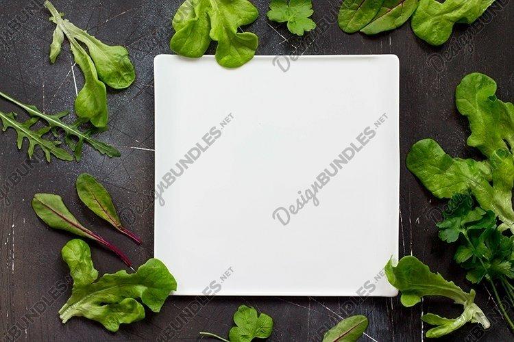 Fresh summer food background. Green various lettuce leaves.