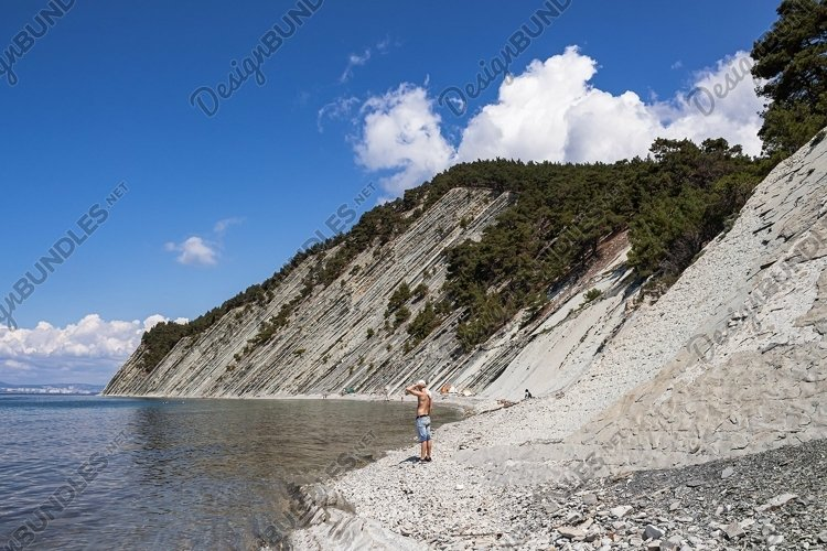 View of the stone wild beach at the foot of the cliffs. 2pcs example image 1