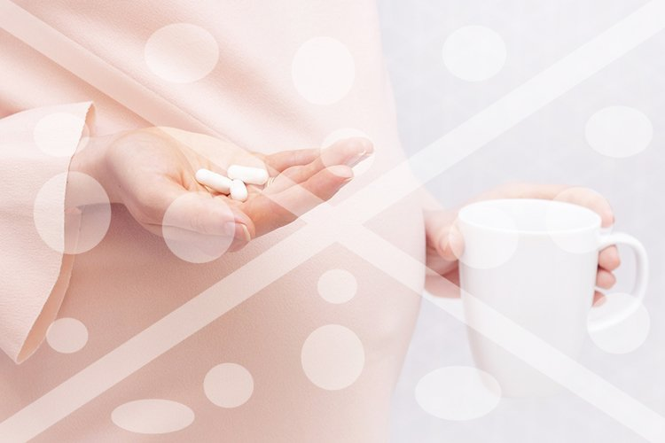 Close-up of pregnant woman holding a pill, vitamins. The con example image 1