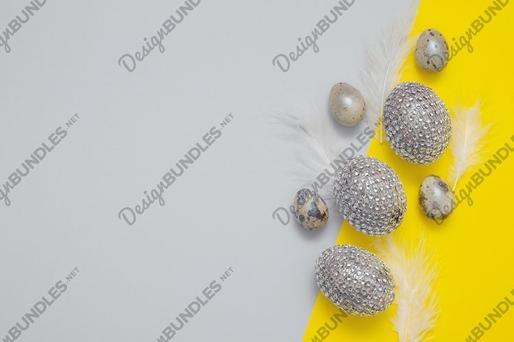 Eggs and feathers on paper background in trend colors example image 1