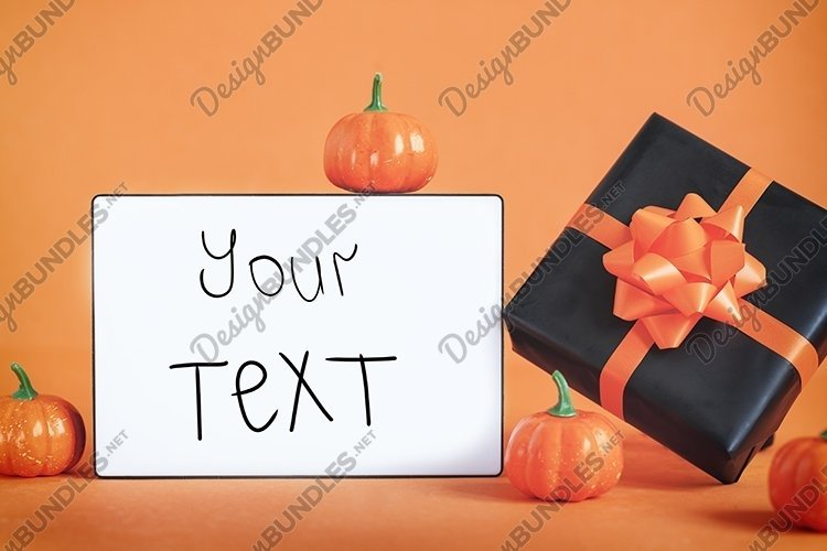 Empty blank lightbox on orange background with black present example image 1