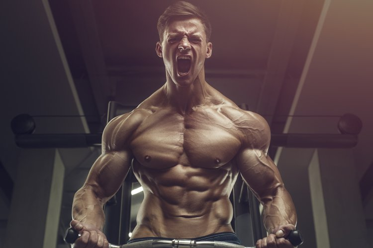 Bodybuilder strong man pumping up biceps muscles example image 1