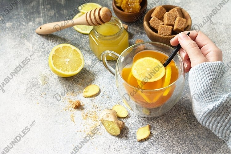 Hot cup of ginger tea and ingredients. example image 1