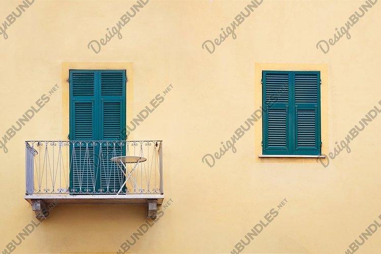 metallicbalcony with green sash door and wooden window