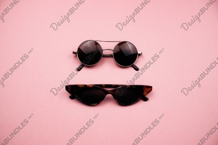 Fashion sunglasses on pink background. Summer concept. example image 1