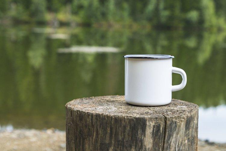 White enamel mug mockup with tree stump example image 1