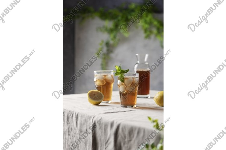 Cold summer tea with lemon and mint, selective focus image example image 1