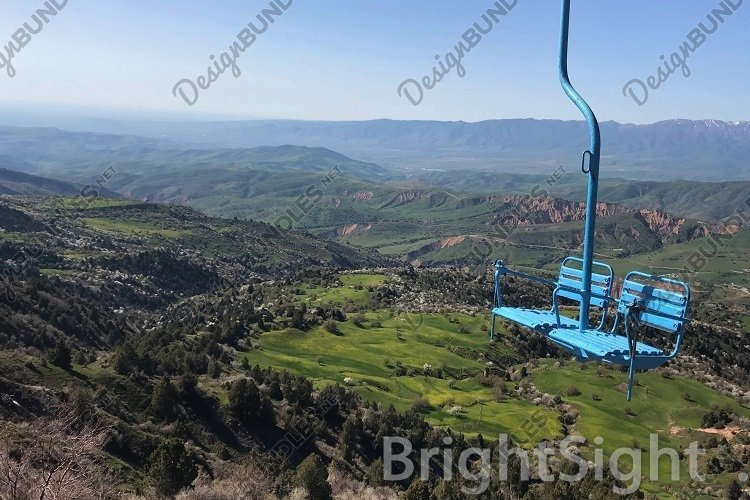 Blue cable car high in the mountaines example image 1