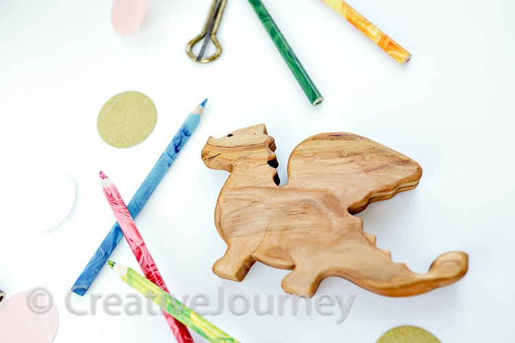 Wooden toy and colored pencils.
