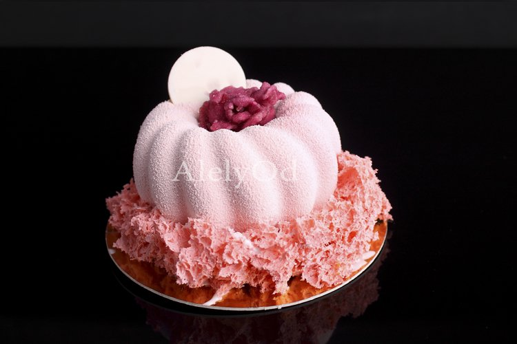 Pink cake with berry mousse in velvet glaze