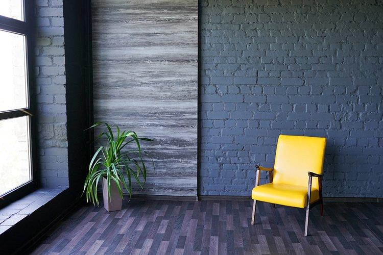 Yellow chair near window in modern dark interior example image 1