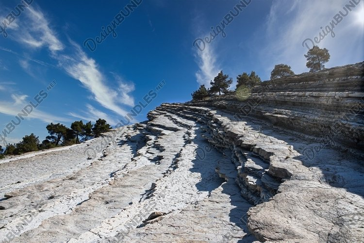 The top of the cliff against the blue sky with clouds. 2pcs example image 1