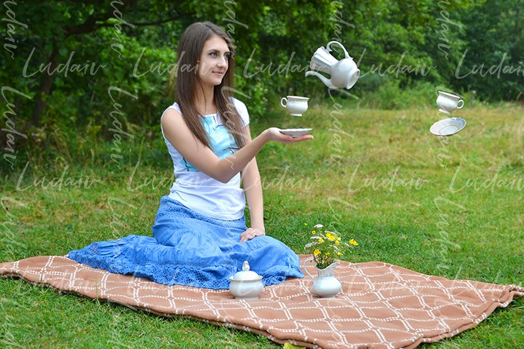 Surreal design. Girl sitting on the grass while drinking tea example image 1