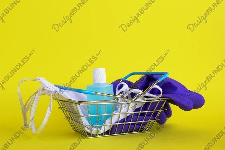 Face masks, medical gloves and bottle of hand sanitizer gel. example image 1