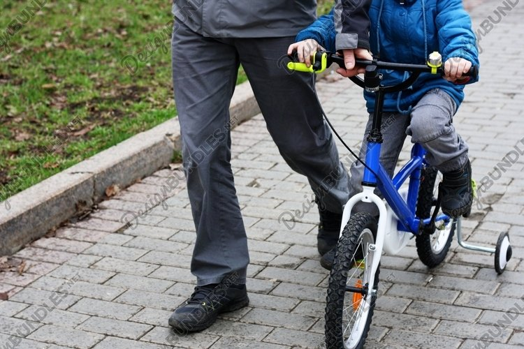 Father and son riding a Bicycle. example image 1