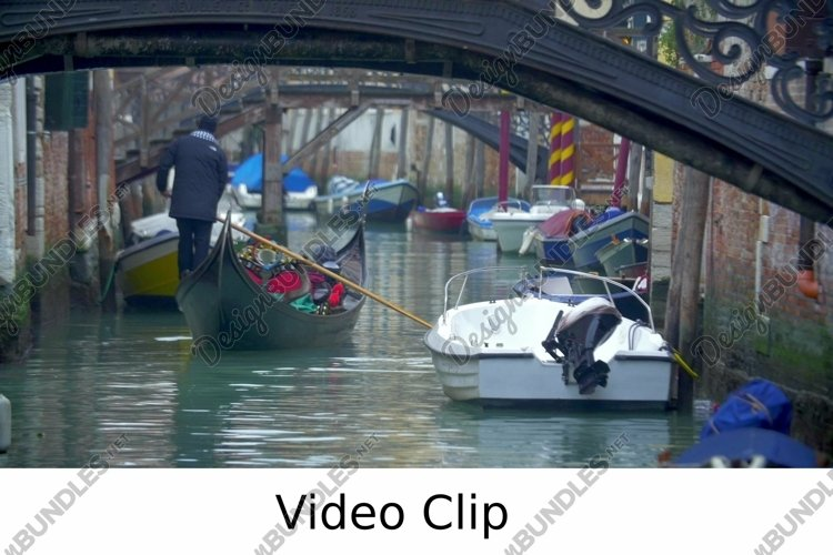 Video: Gondola Sailing Along the Water Canal in Venice. example image 1