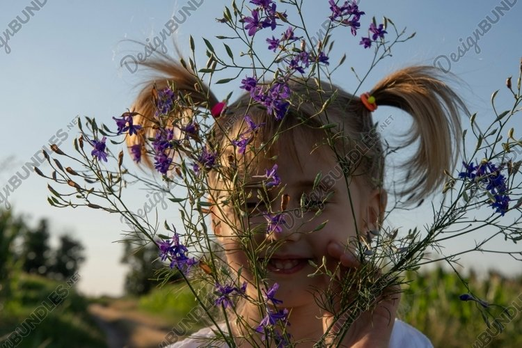 Summer Authentic Portrait of Toddler Girl with Wildflowers