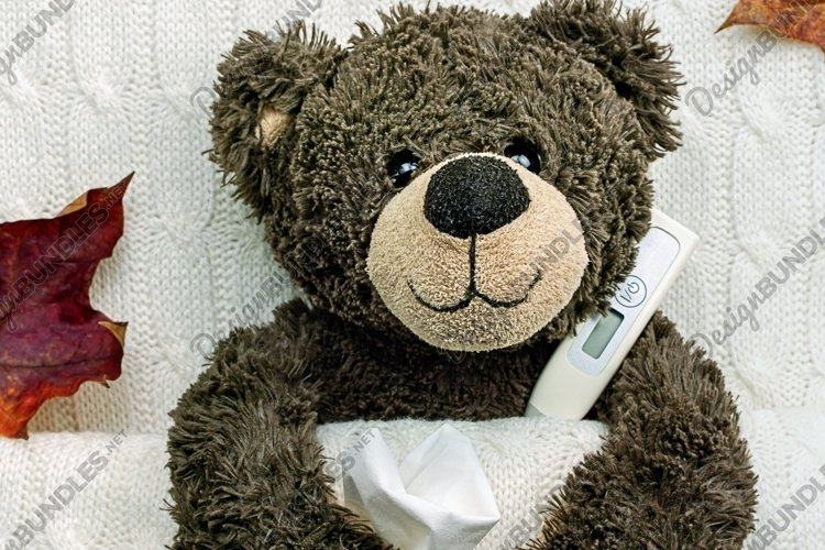 Brown ill teddy bear with thermometer in white bedroom example image 1