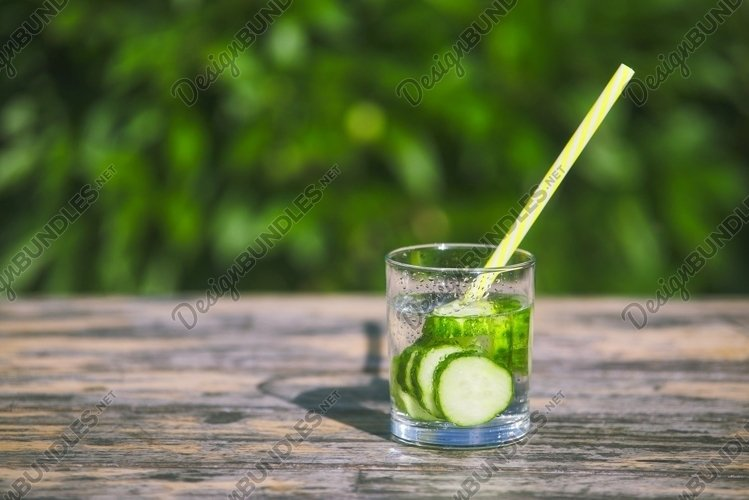 Cucumber cocktail from water in glass with a drinking example image 1