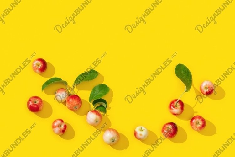 Small red apples frame on yellow background example image 1