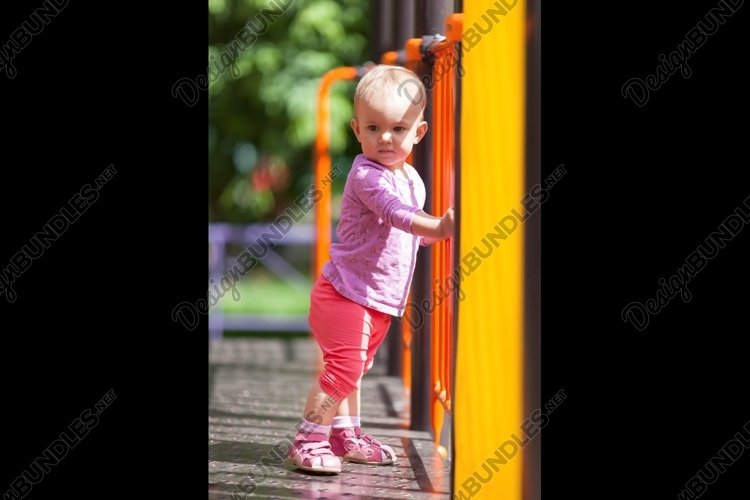 Small infant standing in playground example image 1