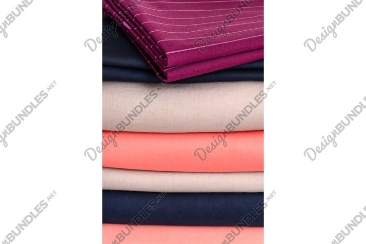 Stack of neatly folded clean colored linens. Background example image 1