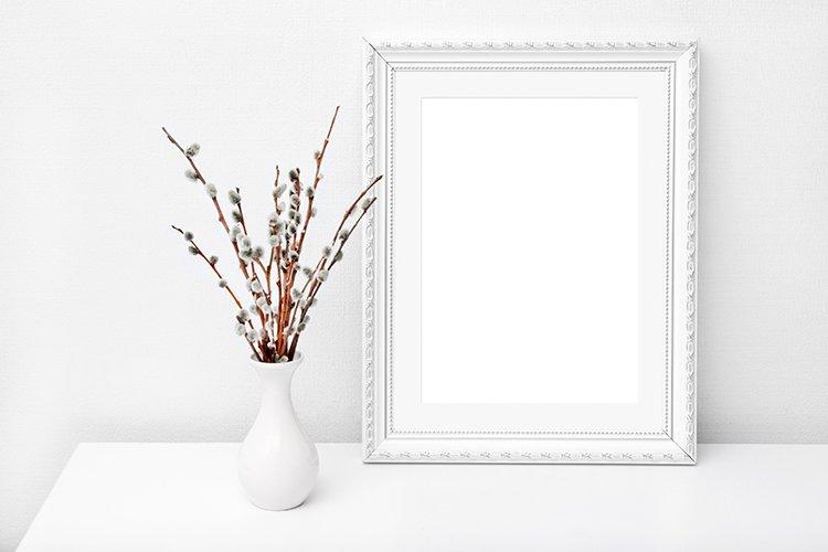 Wooden frame mockup in white interior