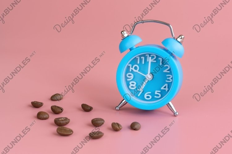 Blue alarm clock and coffee beans on pink background example image 1